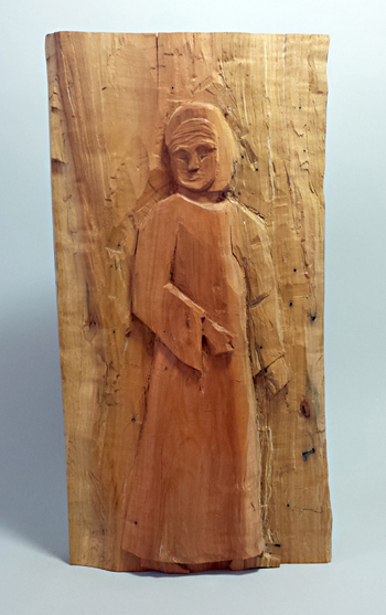 Carving of Woman Seeking Refuge